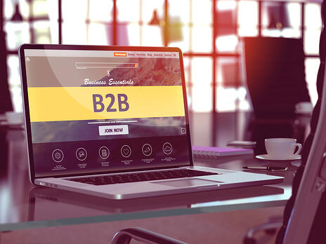 B2B - Business to Business - Concept - Closeup on Laptop Screen in Modern Office Workplace. Toned Image with Selective Focus. 3d Render.